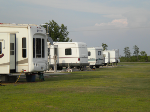 Picture of a row of recreational vehicles parked at Big Lake RV.